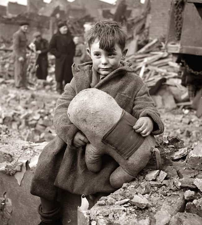 An Abandoned Boy Sitting Amid ... is listed (or ranked) 2 on the list 36 Rare Photos From World War II