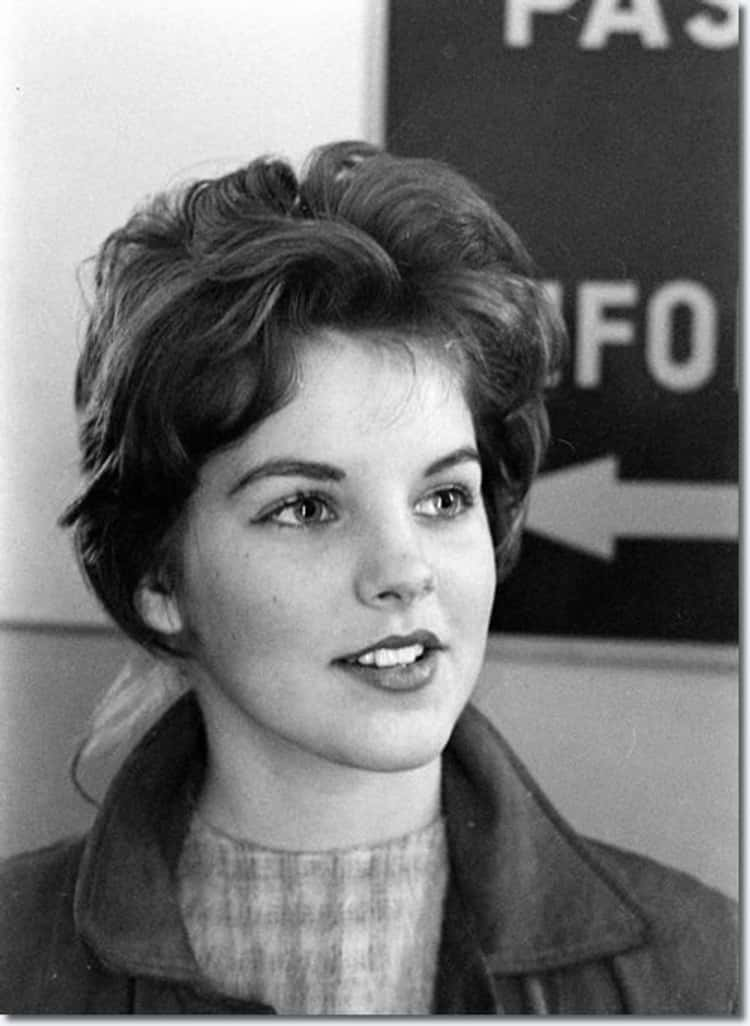 Young Priscilla Presley in a Gray Coat and Turtleneck