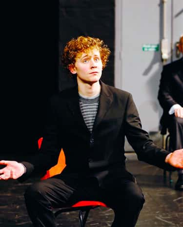 Young Tom Hiddleston in Black Suit and Striped Shirt