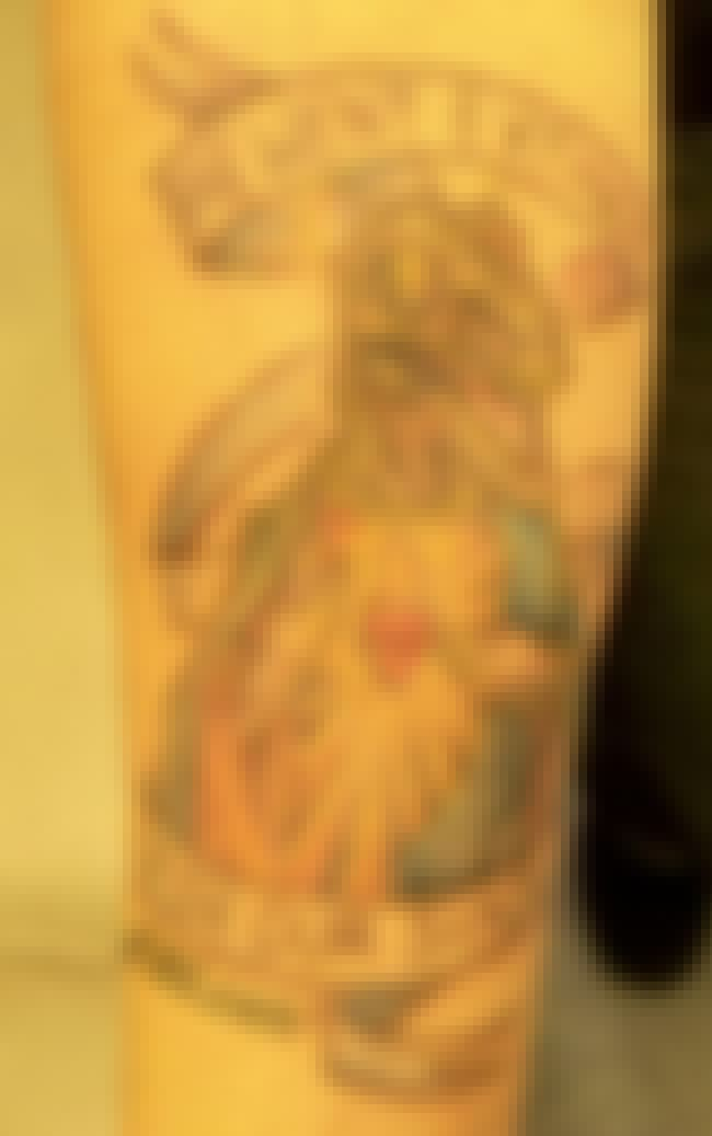 Raptor Rapture is listed (or ranked) 4 on the list 35 Bible Tattoo FAILs That You Won't Believe!