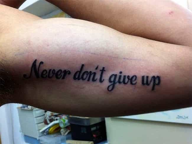 Please Just Give Up is listed (or ranked) 2 on the list The Most Epic Quote Tattoo Fails Ever