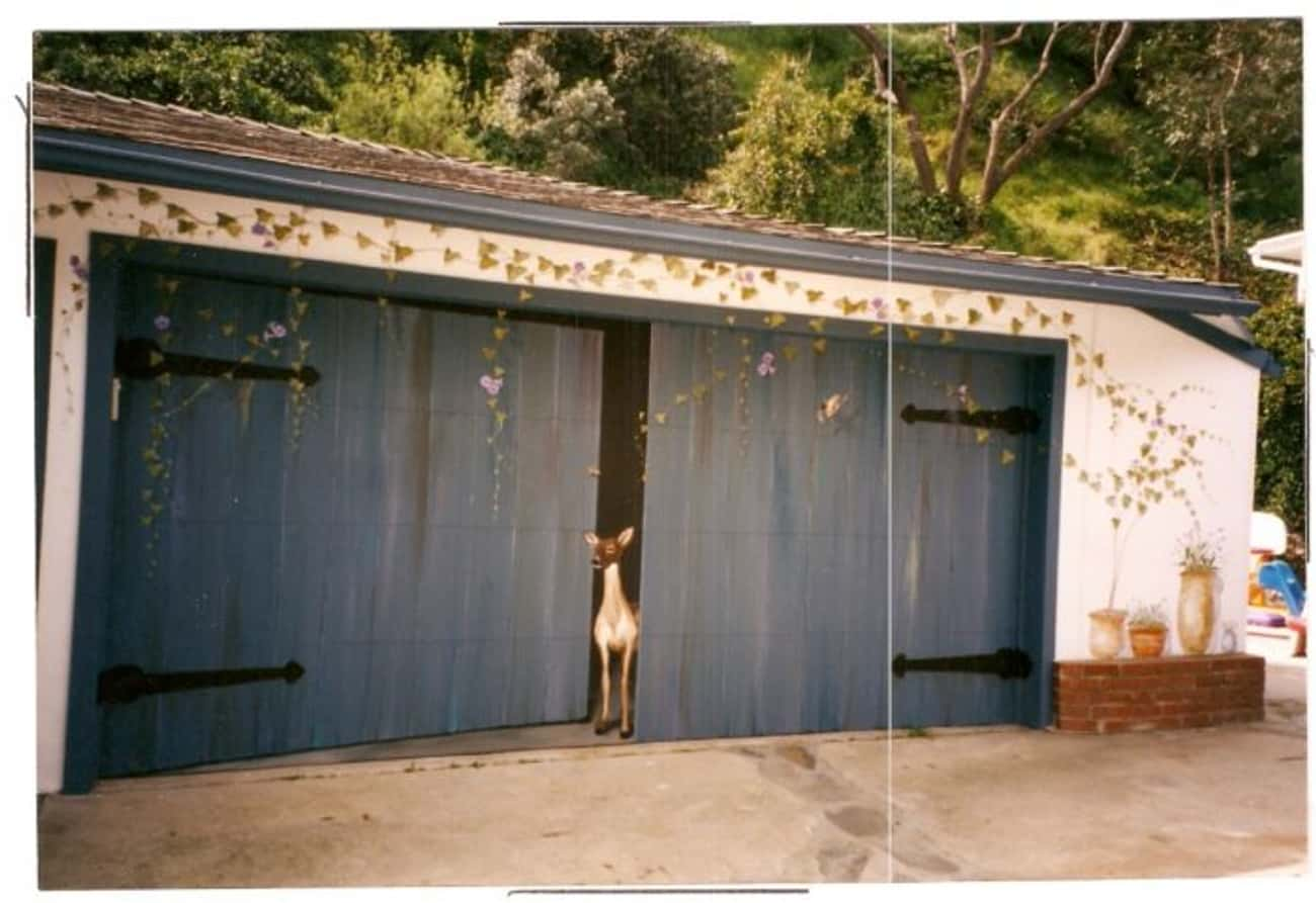Ma, There's A Fake Deer In Our is listed (or ranked) 2 on the list The Most Creative Garage Door Art of All Time