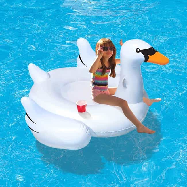 Giant Swan Ride-On is listed (or ranked) 4 on the list Fun Pool Toys And Outdoor Accessories That Will Make Your Backyard Feel Like A Vacation