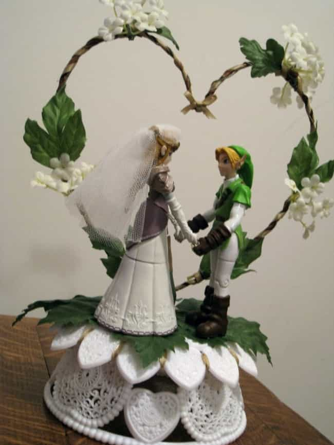 Link and Zelda Fill Their Hear... is listed (or ranked) 3 on the list 39 Magnificently Geeky Wedding Cake Toppers