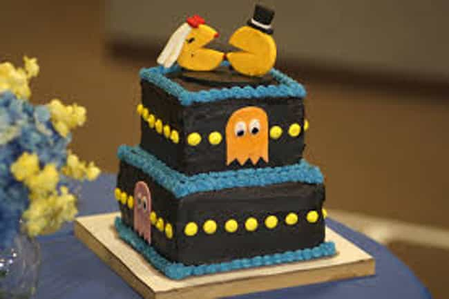Pac-Man Pair Has Bite is listed (or ranked) 4 on the list 39 Magnificently Geeky Wedding Cake Toppers