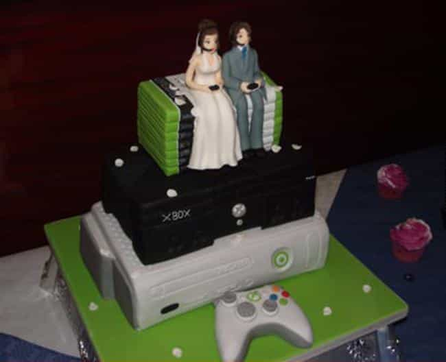 The Couple That Plays Together... is listed (or ranked) 1 on the list 39 Magnificently Geeky Wedding Cake Toppers