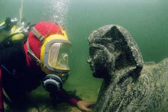 Diver Examines a Sphinx Statue is listed (or ranked) 5 on the list The Most Amazing Photos of Underwater Cities