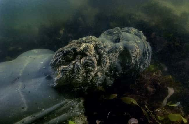 Statue of a Sunken Egyptian Go is listed (or ranked) 13 on the list The Most Amazing Photos of Underwater Cities