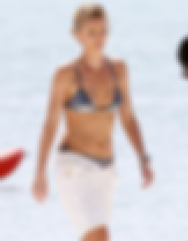 Charlize Theron with her Shiny... is listed (or ranked) 4 on the list Charlize Theron Bikini Pictures