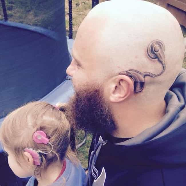 This Adorable Dad Got a ... is listed (or ranked) 1 on the list Parents Who Got Tattoos to Match Their Kids