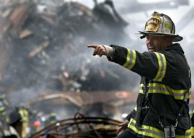 Firefighter Directs the ... is listed (or ranked) 3 on the list Rare, Powerful Photos from September 11, 2001