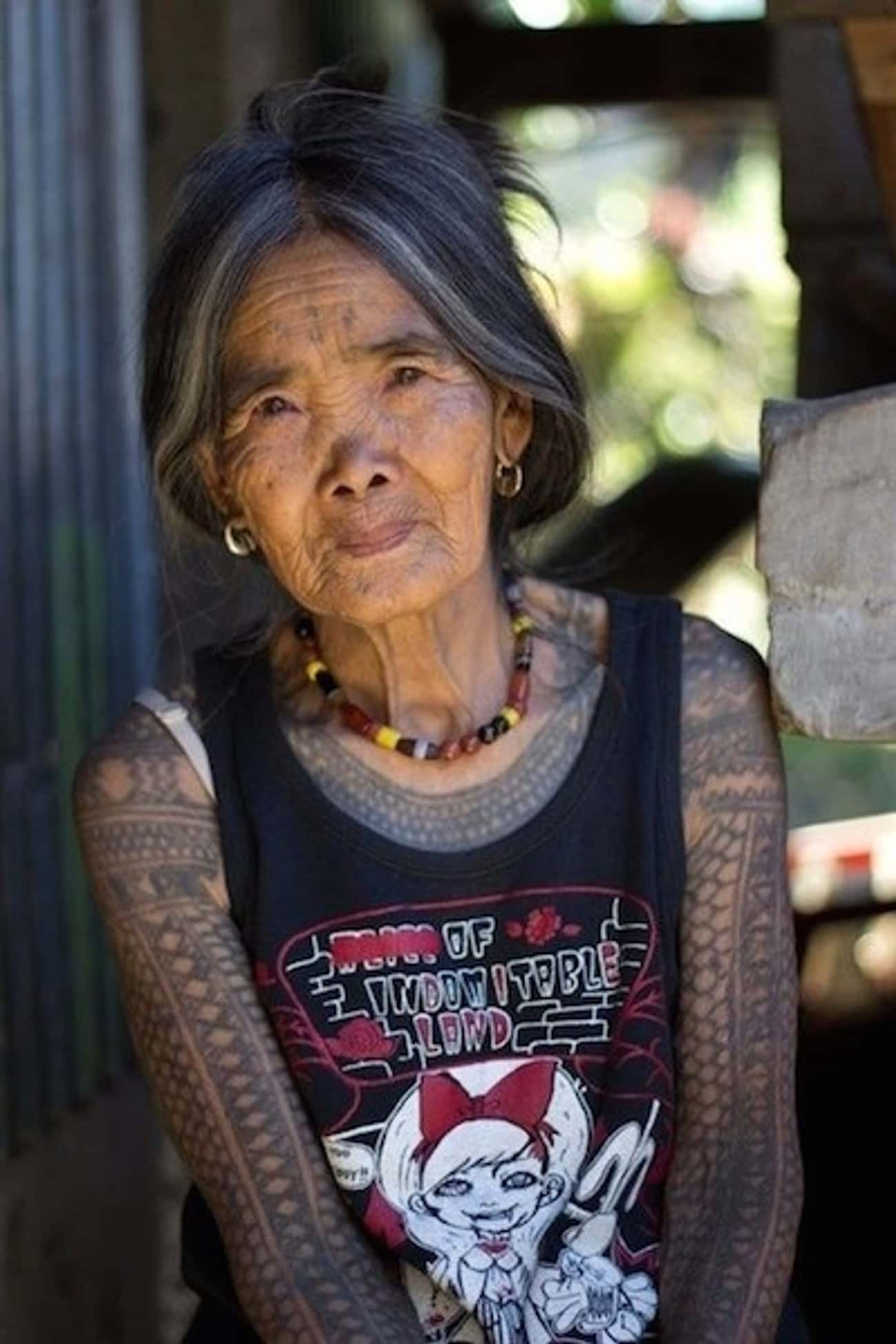 Her Face And Arms Are Full Of  is listed (or ranked) 4 on the list 18 Cool Older People With Tattoos