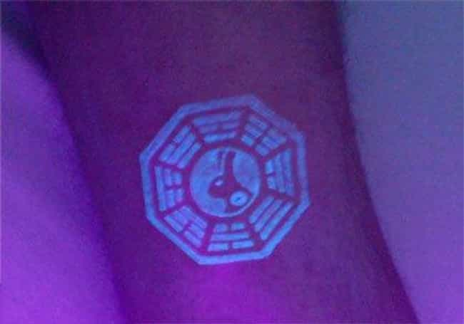 A Really Cool Black Light Alic... is listed (or ranked) 3 on the list 25 Incredible Tattoos Inspired by Lost