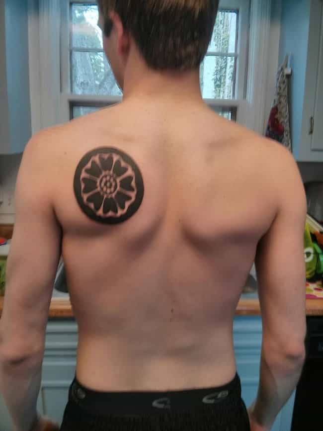 This Bold White Lotus Sy... is listed (or ranked) 8 on the list 26 Incredible Tattoos Inspired by Avatar: The Last Airbender