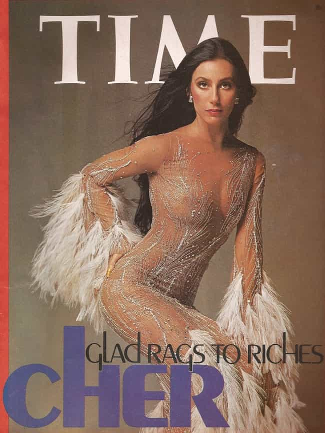 Time for Glitter and Feathers is listed (or ranked) 1 on the list Cher's Outfits Through the Years, Ranked