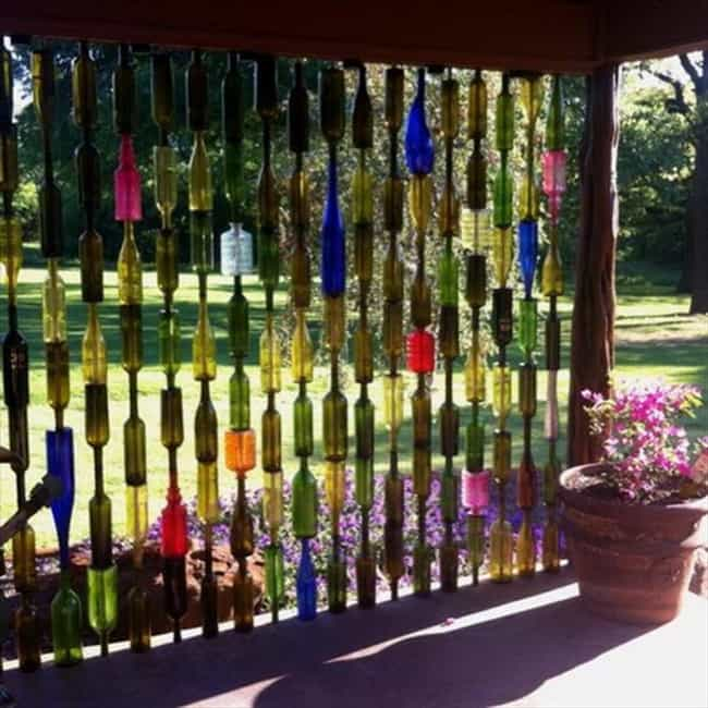 Build a Wine Bottle Curtain is listed (or ranked) 2 on the list Things That You Can Do With Old Wine Bottles