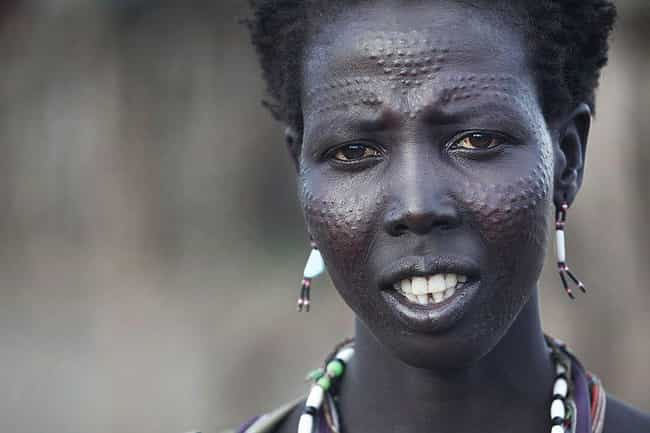 64f8ac04c The scars carved across the faces and bodies of Ethiopian and Sudanese  tribe members are some of themost painful types of scarification known to  man.