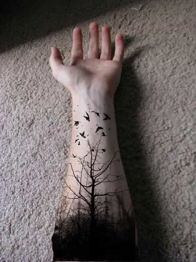 This Dramatic Inky Black Fores... is listed (or ranked) 1 on the list 45 Amazing Nature Tattoos