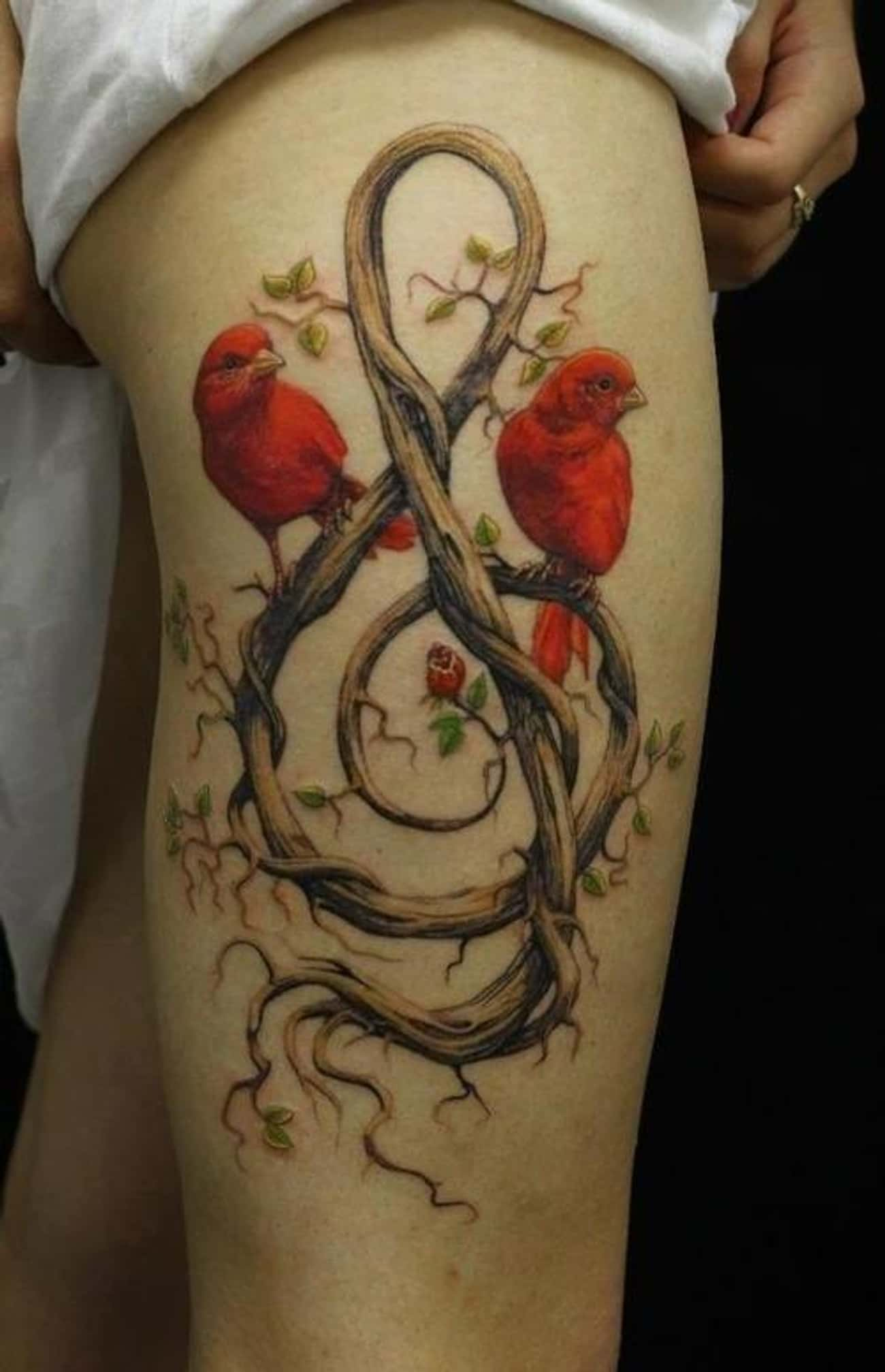 This Intricate Tattoo of Love  is listed (or ranked) 4 on the list 45 Amazing Nature Tattoos