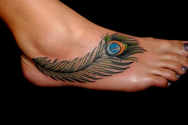 Peacock Feather Foot Tattoo is listed (or ranked) 2 on the list Foot Tattoo Placement Designs and Ideas