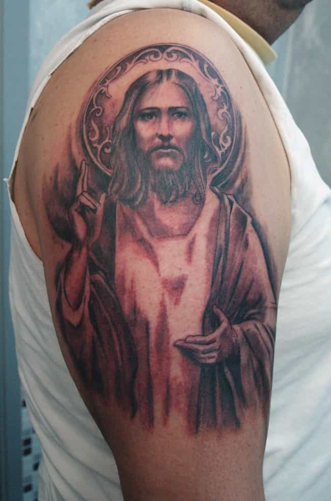 Jesus Tattoo On Arm is listed (or ranked) 3 on the list 24 Inspiring Christian Tattoo Ideas For People of Faith