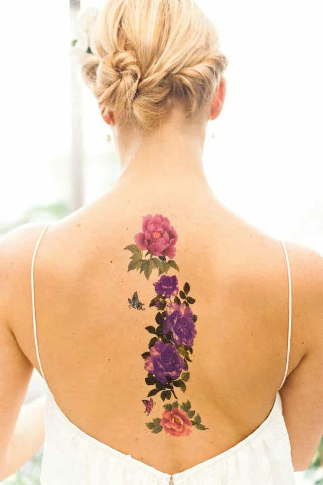 Rose Spine Tattoo is listed (or ranked) 2 on the list 25 Ideas to Get a Tattoo Right Up Your Spine