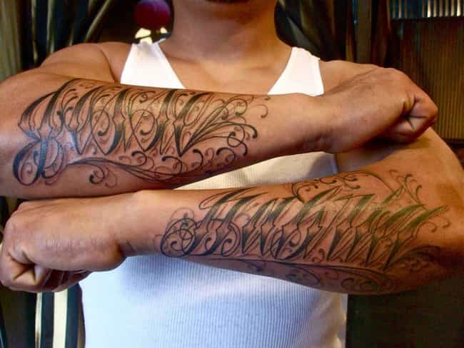 Flowing Script Roman Numeral T... is listed (or ranked) 4 on the list Roman Numeral Tattoo Ideas
