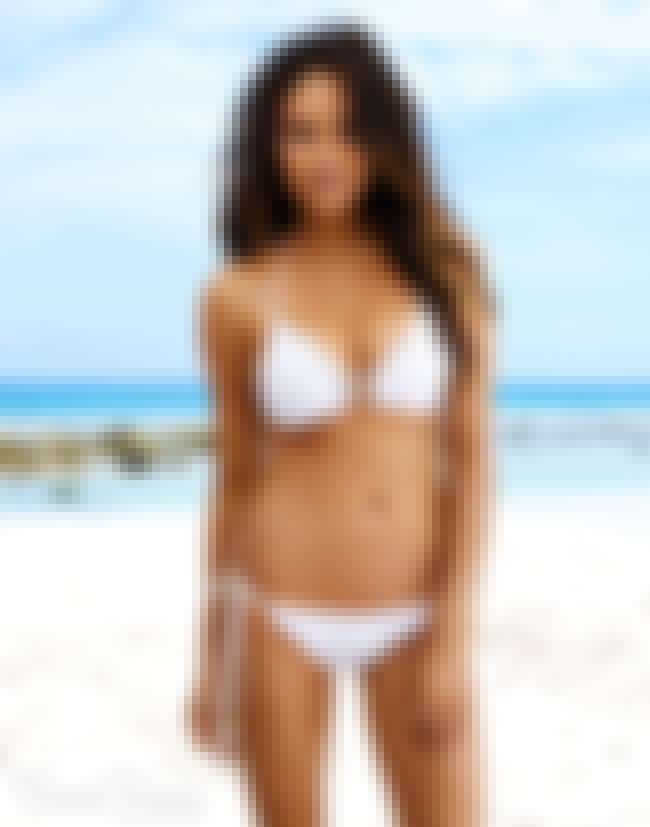 Chrissy Teigen in her white bi... is listed (or ranked) 4 on the list The Hottest Chrissy Teigen Bikini Pictures