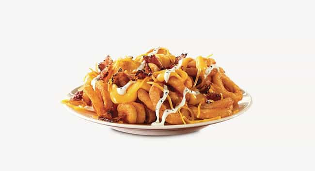 Arby's Loaded Curly Fries is listed (or ranked) 1 on the list Ranking the Most Delicious Plates of Fast Food Loaded Fries