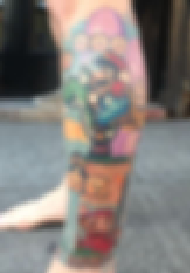 Early Mario Tribute is listed (or ranked) 3 on the list 23 Tattoos Inspired by Mario Bros.