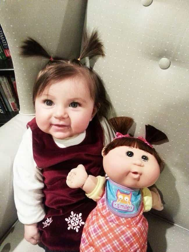 These Preciously Pig-Tailed Ca... is listed (or ranked) 3 on the list 27 Kids Who Look Just Like Their Dolls