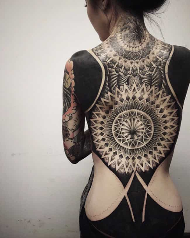 This Incredibly Intricate Back... is listed (or ranked) 1 on the list Beautiful Photos of the Newest Trend: Blackout Tattoos