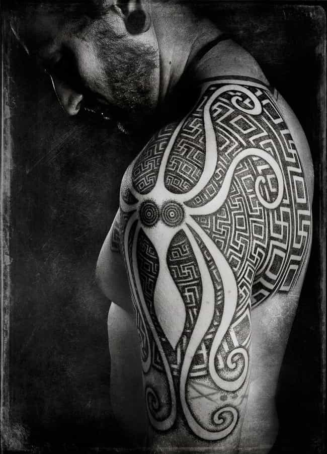 Shapes and Lines is listed (or ranked) 4 on the list Beautiful Photos of the Newest Trend: Blackout Tattoos