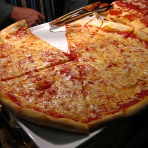 Gino's Pizza in Bayside is listed (or ranked) 13 on the list The Best Pizza in New York City