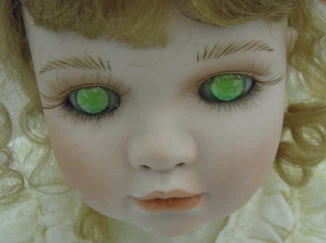 Porcelain Doll, Vacant Green E... is listed (or ranked) 1 on the list 18 of the Creepiest Dolls You Can Buy on EBay