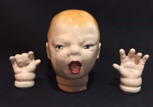 Creepy Baby Doll Head and Hand... is listed (or ranked) 3 on the list 18 of the Creepiest Dolls You Can Buy on EBay