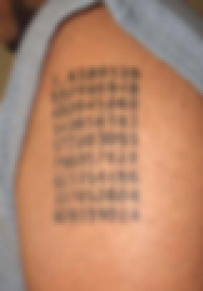 This Guy's Tat Shows the G... is listed (or ranked) 3 on the list Mystifying Math Tattoos You'll Never Get the Answer To