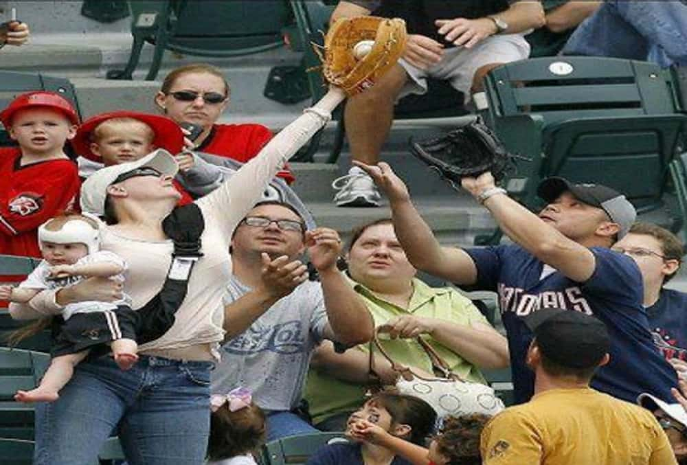 Mom of the Year is listed (or ranked) 1 on the list The 25 Funniest MLB Fan Photos Ever