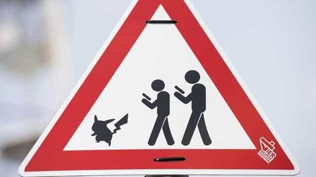 Pokemon Go Crossing is listed (or ranked) 1 on the list Hilarious Pokemon Go Signs
