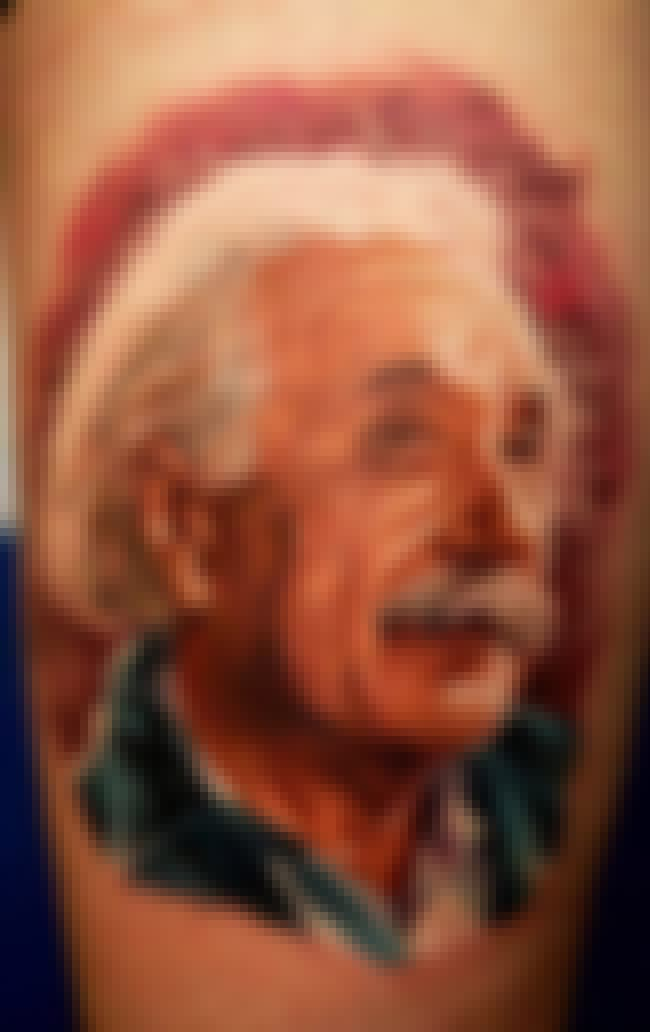 This Einstein Tat's Sure T... is listed (or ranked) 2 on the list People With Tattoos Of Historical People & Events