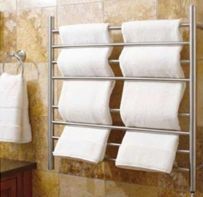 Heated Towel Rack is listed (or ranked) 3 on the list Genius Bathroom Inventions You Didn't Realize You Needed