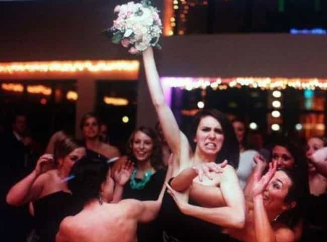 This. Is. BOUQUET!!! is listed (or ranked) 2 on the list Amazing Wedding Bouquet Toss Moments Caught on Film