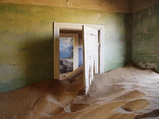 Kolmanskop, Namibia: Swallowed... is listed (or ranked) 1 on the list 10 Eerie Ghost Towns and the Disasters That Made Them