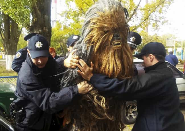 21 Hilarious Pictures of People Being Arrested in Costume
