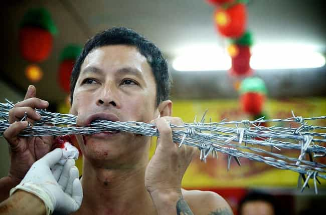 "Barbed Wire Through The ... is listed (or ranked) 3 on the list Bloody Details From Thailand's Sacred ""Self-Mutilation"" Festival"