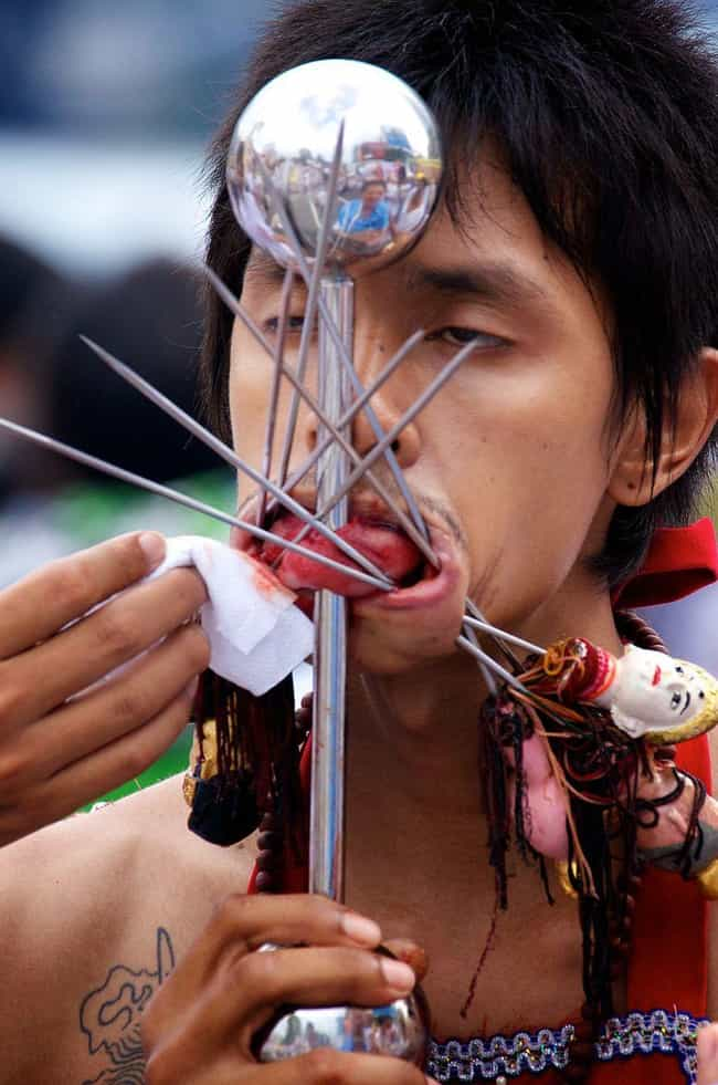 "Human Pincushions is listed (or ranked) 1 on the list Bloody Details From Thailand's Sacred ""Self-Mutilation"" Festival"