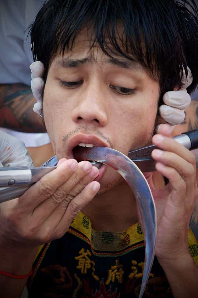 "Meat Hooks Through The B... is listed (or ranked) 4 on the list Bloody Details From Thailand's Sacred ""Self-Mutilation"" Festival"
