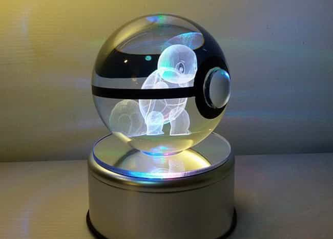 Crystal Pokeball With Ro... is listed (or ranked) 2 on the list 28 Inexpensive Gifts Every Pokemon Master Will Love