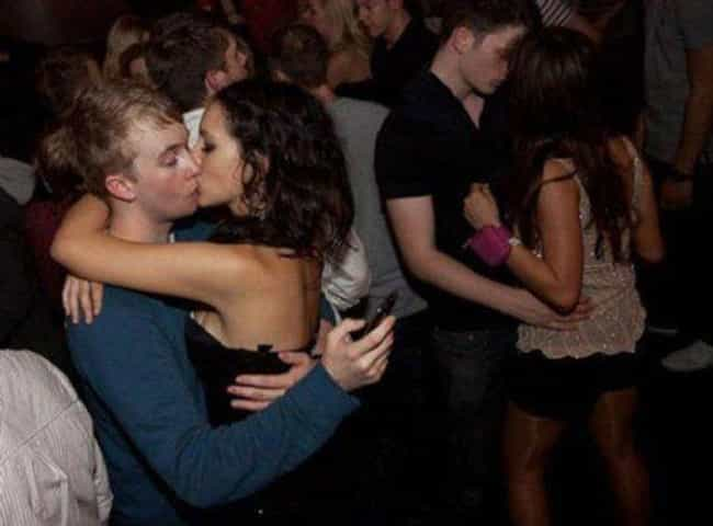 Kiss And Tell Your Follo... is listed (or ranked) 4 on the list 28 Photos That Prove We're Too Obsessed With Our Phones