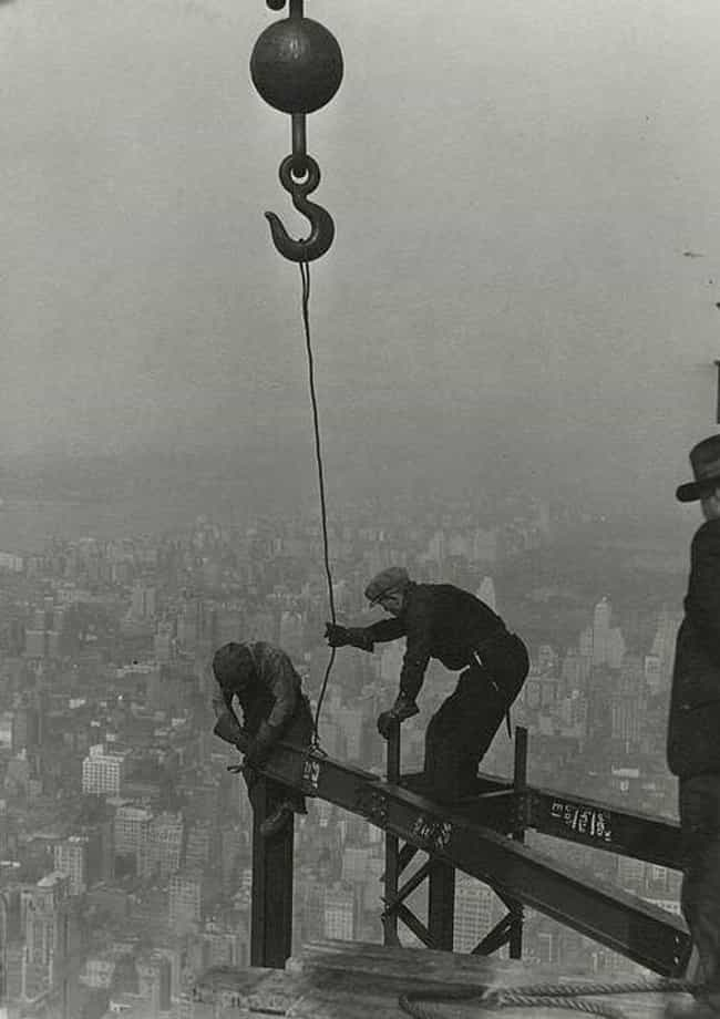Two Workers Attaching A Beam W... is listed (or ranked) 4 on the list 23 Stunning Photos of the Empire State Building Under Construction